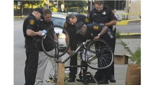 Police Inspecting a Crashed Bike